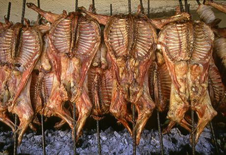 Cabrito is prepared by roasting it on a bed of charcoal or ...
