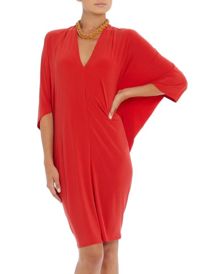 This Tanara dress by Tiaan Nagel is cut to fit just beautifully. It's available on spree here: http://www.spree.co.za/tanara-dress-orange.