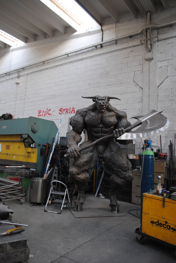 it is so huge, picture could be taken only from a distance. Height 3,6 m, Weight 1200 kg, Material- Iron scrap metal /plates /