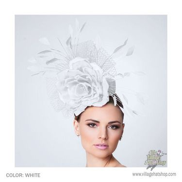 The Alyssa is a white headpiece made on a small pillbox base, covered with burnout silk, a big silk satin rose, French veil and adorned with coque feathers. This fascinator is perfect for a cocktail party or Opening Day at the races and will surely turn heads!