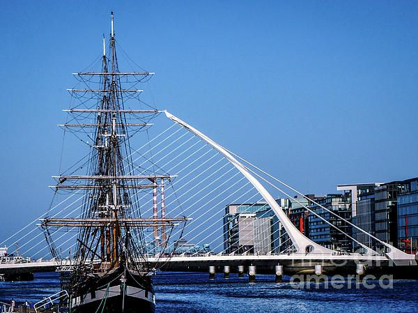 Dublins Three Icons. Samuel Beckitt Bridge, Jeannie Johnston Tall Ship and Poolbeg Chimneys. Ireland. Visit my photo gallery and get a beautiful Fine Art Print, Canvas Print, Metal or Acrylic Print OR Home Decor products. 30 days money back guarantee on every purchase so don't hesitate to add some Irish Magic in your home or office.