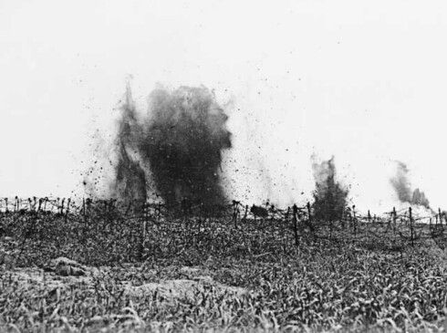 Canadian shells falling on the barbed wire protecting the German lines prior to the Canadian advance there of 9–12 April 1917 during the Battle of Vimy Ridge. [AWM H07021]