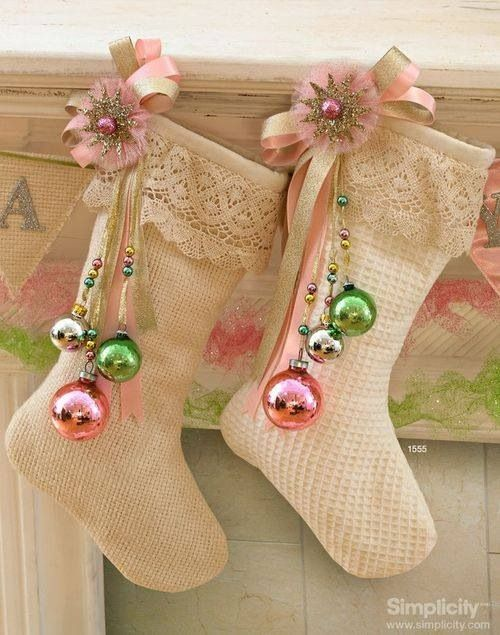 """really like the way they displayed the Christmas Ornaments on these """"burlap""""(?) Christmas Stockings."""