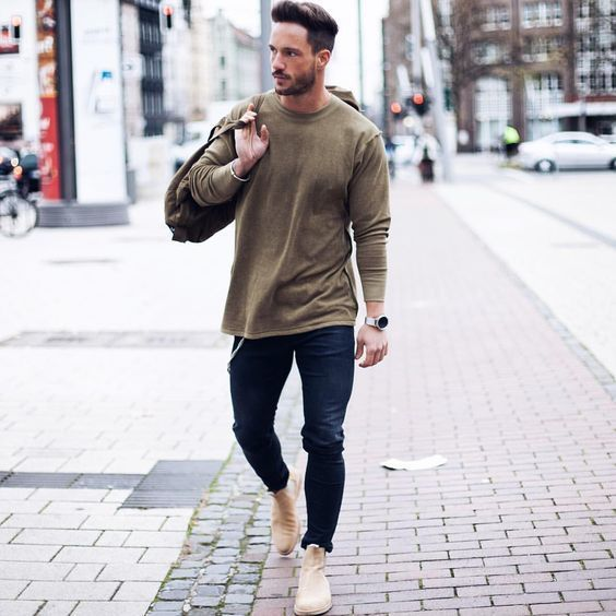 Pair an olive crew-neck pullover with dark blue skinny jeans for a comfortable outfit that's also put together nicely. Feeling inventive? Complement your outfit with camel suede chelsea boots.   Shop this look on Lookastic: https://lookastic.com/men/looks/crew-neck-sweater-skinny-jeans-chelsea-boots/18398   — Olive Crew-neck Sweater  — Olive Canvas Holdall  — Silver Watch  — Navy Skinny Jeans  — Tan Suede Chelsea Boots