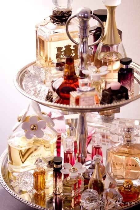Au couture mon amour!  Turn high society liquor servers into high society perfume displays.  THIS is a woman's world.