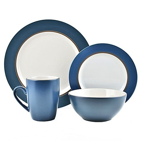 Sleek and stylish with unique curves, the Thomson Pottery 16-Piece Kensington Stoneware Dinner Set in white and blue will complement any table setting. The striking set includes four each: 10-1/2 dinner plates, 8 salad plates, 6 bowls, and 8 oz. cups.