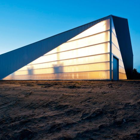 Danish architecture studio CEBRA has combined standardised corrugated metal roof sheets with translucent plastic panels to construct this sports hall.:
