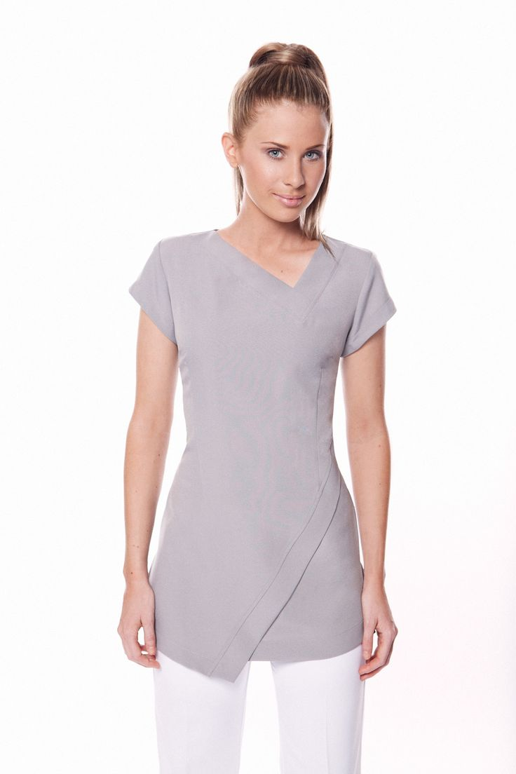 Very comfortable and practical to work in with a professional look. Abstract hem line and neck line, zips at the rear with cap sleeves This tunic is long enough to cover your bottom. Fabric Cool easy wash and wear corporate grade fabric with a gentle stretch. Bleach resistant and no ironing Colours Black, white, Charcoal grey, dove grey( light grey) hot pink & electric blue Sizes 4-30, please view our sizing chart attached Click here to view Size Chart