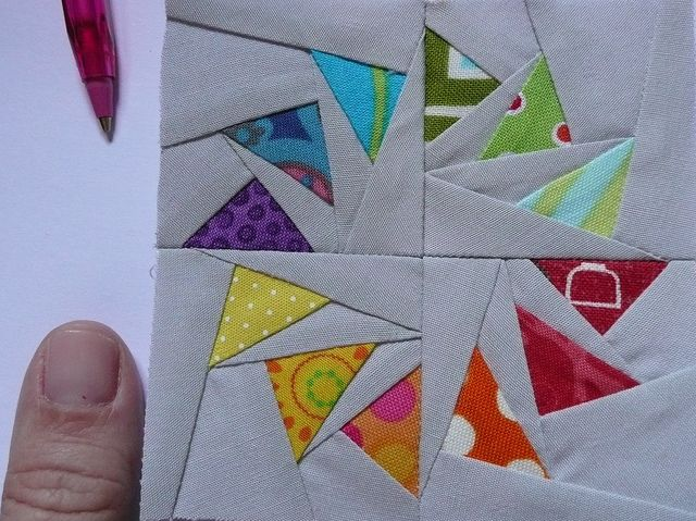 Tiny circle flying geese | Flickr - Photo Sharing! Very intriguing block. I'd like to see it in a quilt. Maybe a line of these as a runner?