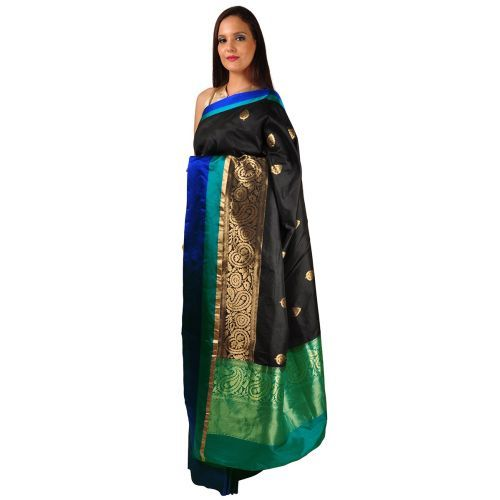 Talking Threads presents its Banaras Timeless Treasure Collection, with each sari befitting a place in a wedding trousseau or a seasoned saree collector's wardrobe. This black pure butter silk saree has gold zari booteh weave all over with peacock green a