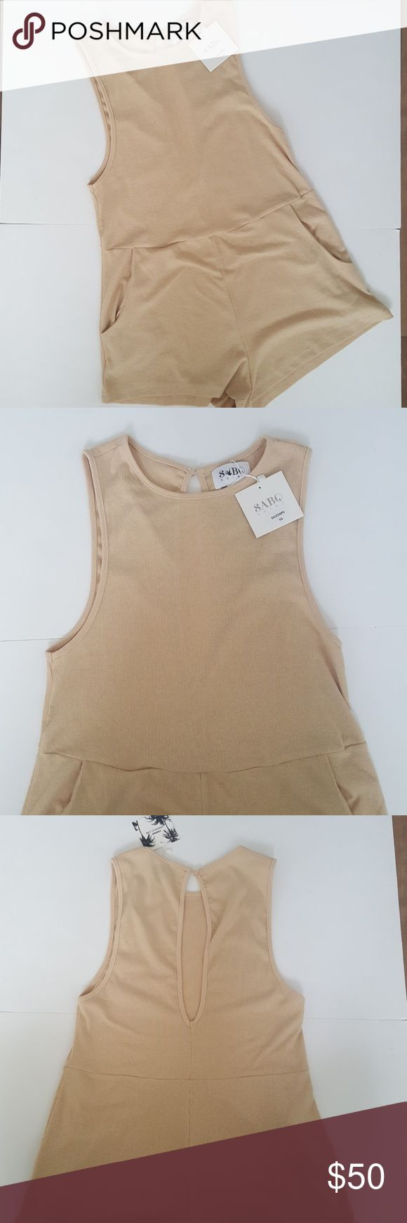 """Sabo Skirt Bardot Beige Playsuit Cute ribbed tank style playsuit. Features large back keyhole opening with single button closure, front pockets and wide scoop armholes. Stock images provided to show fit. Bust 16"""" Length 29"""" Inseam 1 1/2"""" Sabo Skirt Pants Jumpsuits & Rompers"""