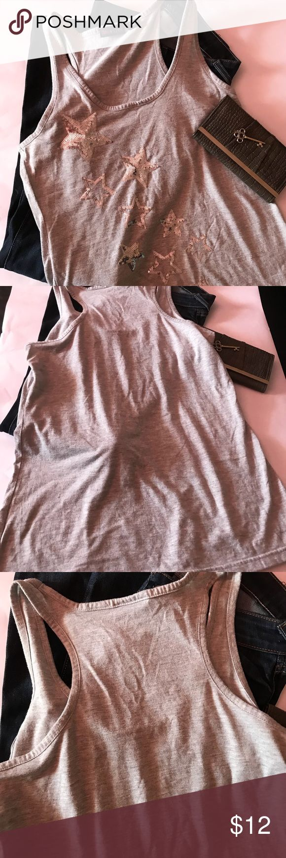 Super Star Silver Sequined Top by Ultra Flirt L In gently used condition size large Top. No rips or stains. By Ultraflirt Stars with Sequins Design 🚭 from a Smoke Free 🐕 No Pets in Home  ⭐️⭐️⭐️⭐️⭐️Top rated Seller 🎥 Scam Alert-All Items are inspected and videotaped for a fair transaction; if there is a damage/defect it will be noted. 💕Posh Blessings Your Way for Smooth Transaction💕 🌸Thank You for stopping by our closet Ultra Flirt Tops Tank Tops