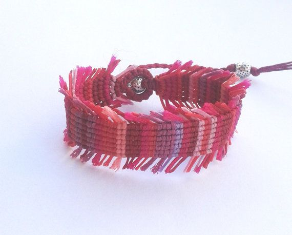 A unique bracelet, made with knots according to the ancient art of macrame.    Beautiful colours in shade of red and pink, add a boho chic style to any