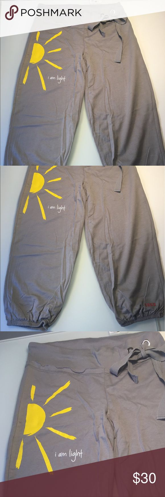 """Peace Love World  I am light sweatpants Peace Love World drawstring grey sweatpants, very cute and fun! On the right leg it has an sun and the words """" I am light"""".  On the back says: Love is not something you look for ... Love is something you become.  NWOT. Size Small Peace Love World Pants Track Pants & Joggers"""