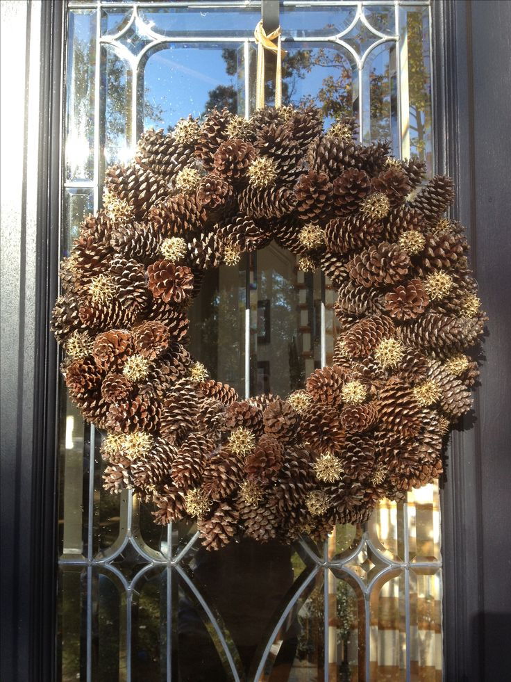 Pinecones and gold painted china balls (those painful thing you step on that fall from a gum tree) glued on a raffia wrapped styrofoam wreath :).