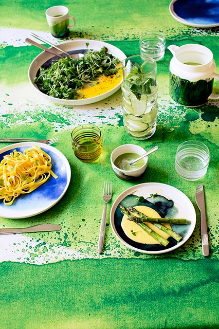 Take A Chance On This Bold Home-Decor Color Trend #refinery29  http://www.refinery29.com/marimekko-2015-spring-home-lookbook#slide2  A crazy, messy looking dinner. We want to be invited.