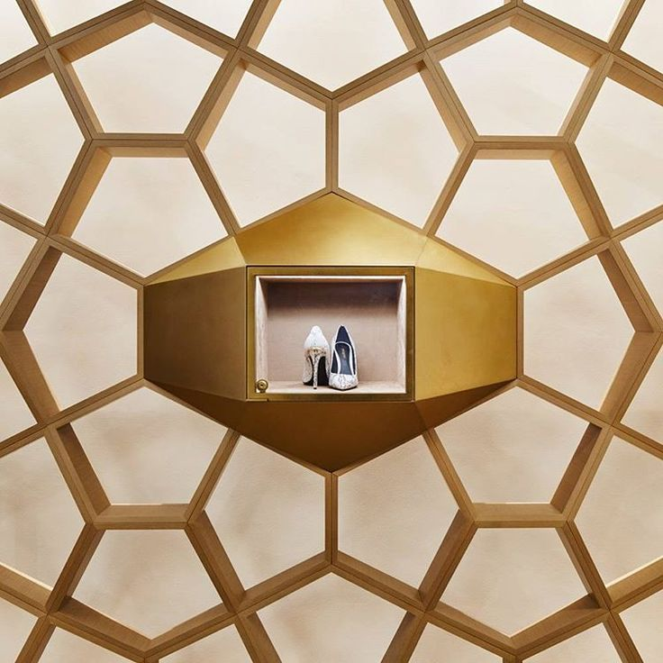 "SHINSEGAE DEPARTMENT STORE, Seoul, South-Korea, ""This stunning feature wall in the shoe department takes on the geometric form of a beehive, symbolic for the department's new focus on community gathering', photo by VMSD Magazine, pinned by Ton van der Veer"