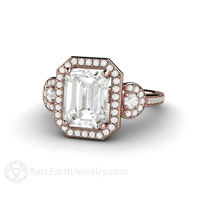 White Sapphire Engagement Ring Halo 3 Stone Sapphire Ring Emerald Cut Diamond Halo Conflict Free Engagement by RareEarth on Etsy https://www.etsy.com/listing/220110539/white-sapphire-engagement-ring-halo-3