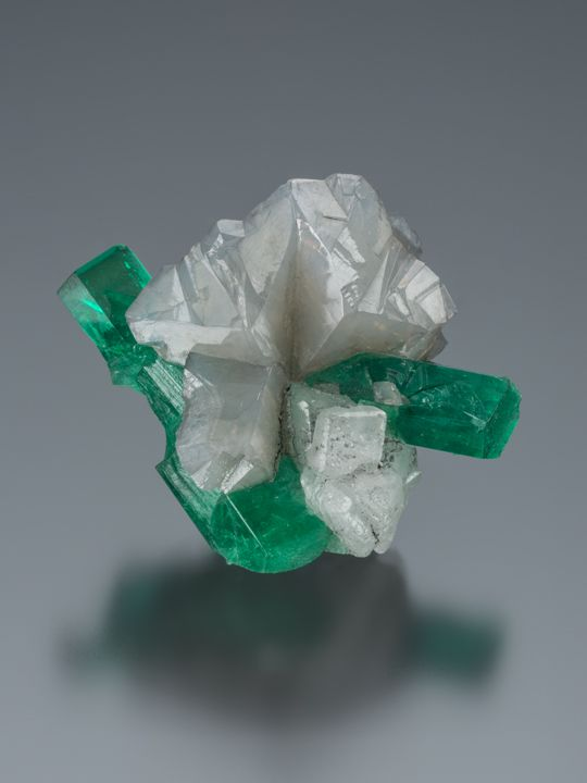 Emerald on Calcite This emerald-on-calcite specimen is from the La Pita mine in Colombia. Photo by Robert Weldon/GIA, courtesy Gem & Mineral Department, Natural History Museum of Los Angeles County.