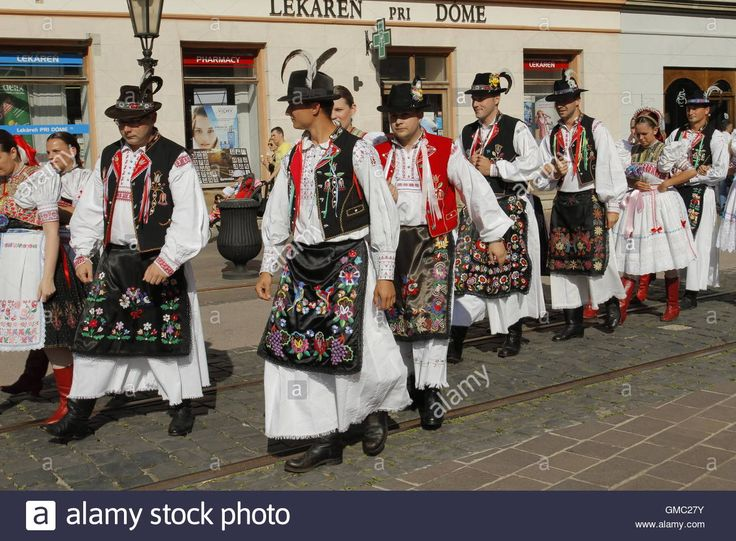 Slovak folklore ensemble during a parade through the historical centre of Kosice at the Cassovia Folkfest, Kosice, Slovakia