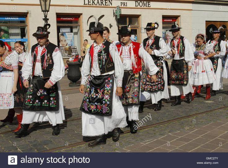 Slovak folklore ensemble during a parade through the historical centre of Kosice at the Cassovia Folkfest, Kosice, Slovakia
