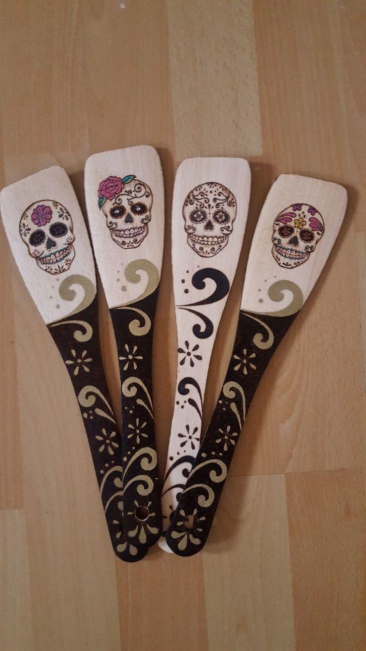 Kitchen spoons with sugar skulls