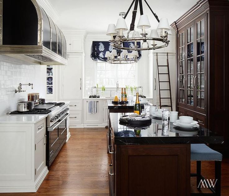 Beautiful A Cooku0027s Kitchen Features Pair Of Black Leather Strap Chandeliers, Ralph  Lauren Westbury Chandeliers, Illuminating Side By Side Walnut Islands Toppu2026 Part 10