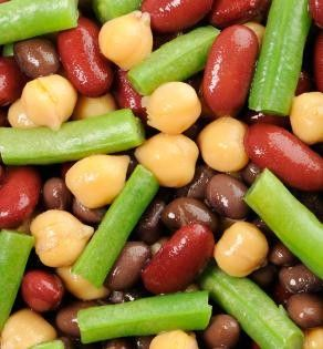 Vegan Four Bean Easter Salad, this recipe looks so delicious! Perfect side dish to make sure everyone at your Easter table is eating healthy! | vegan she knows