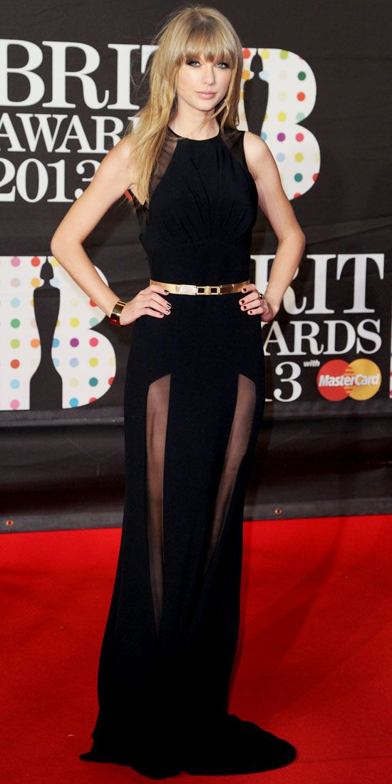 Taylor Swift  WHAT SHE WORE  At the Brit Awards, Taylor Swift played peek-a-boo in a belted Elie Saab gown and gold Neil Lane jewels.     WHY WE LOVE IT  This sweet dresser went to the dark side in a sheer paneled black design.