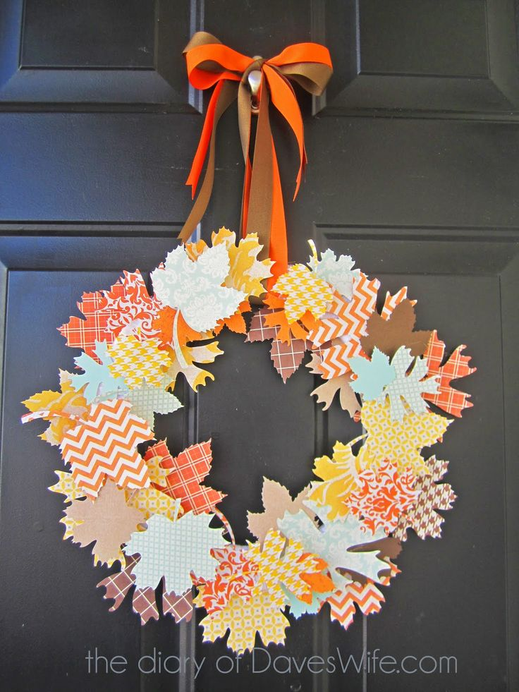 I LOVE this paper leaf wreath! This is so festive and looks super easy... Can't wait to try it!          You need to get scrapbook paper in an array of patterns and colors; cut the leaf shapes, then glue in place on a styrofoam wreath and hang with ribbon!