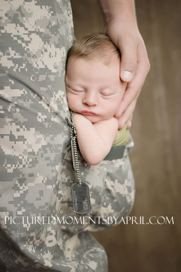 newborn boy sleeping inside the cargo pocket of Army Dad's ACU pants...oh my this is precious!  Remember this if I ever get the opportunity to shoot a military baby!