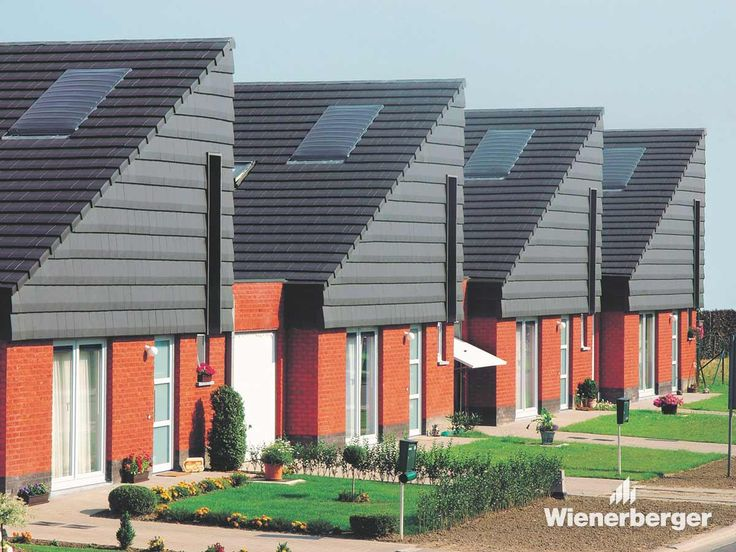 12 social housing units with roofs covered with the Koramic Migeon Actua clay roof tile by Wienerberger.