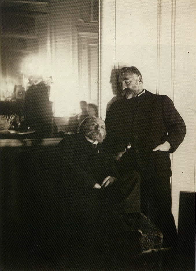 Pierre-Auguste Renoir (seated) and Stéphane Mallarmé (standing), 1895 photographed by Edgar Degas (reflected in the mirror.   (http://imagesanalyses.univ-paris1.fr/analysis.php?analysis=34)