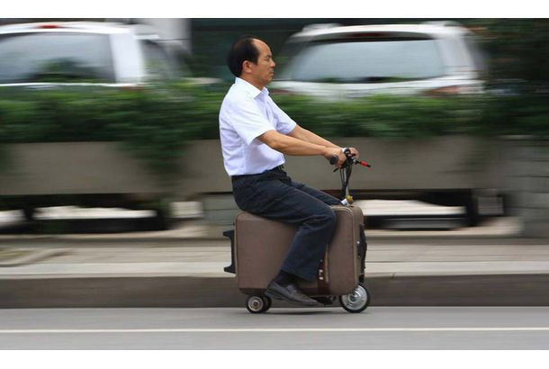 chinese farmer builds a fully-functioning suitcase scooter