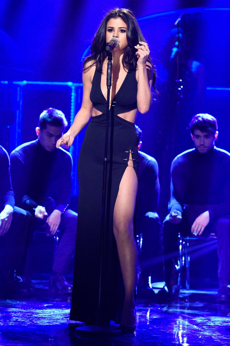 23 January Selena Gomez performed on SNL wearing a daring cut-away black dress.   - HarpersBAZAAR.co.uk