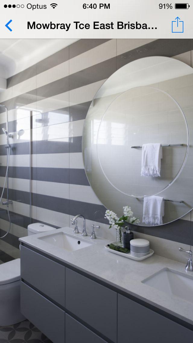 Vanity - Handless 2pac satin finish vanity with Quantum Quartz bench top Love the tiles and mirror www.shaftesburykitchens.com.au