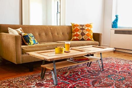 Build a coffee table from a salvaged cabinet door and prefab steel legs for just $45! | Photo: Ryan Benyi | Complete instructions @ thisoldhouse.com