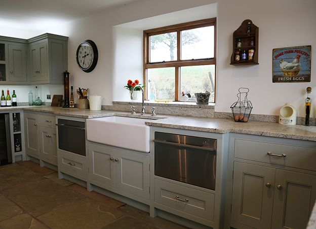 1000mm Belfast Sink from Shaws of Darwen, two Fisher and Pakel Dishwasher drawers either side, Cabinets by Eastburns Country Furniture painted in Farrow and Ball Light Blue