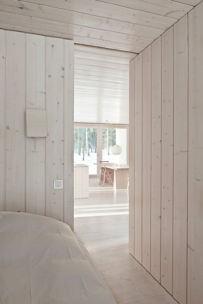 A sustainable Finnish cabin/ white washed wood panelling. via 'My Scandinavian Home blog'.