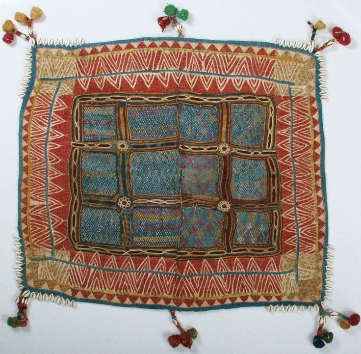Banjara Cradle cloth from Rajasthan, India. A lovely heavy cloth embellished with decorative quilting,embroidery and reverse applique edged with tassels and cowrie shells. 84cm x 75cm. This would look wonderful as a wall hanging Approx 80 years old.
