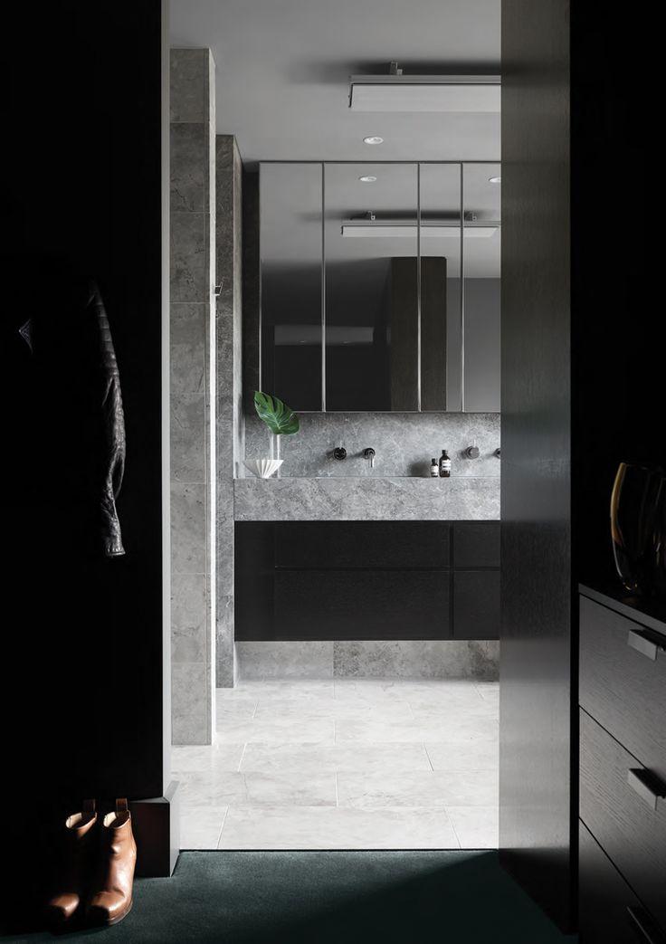 A rich and moody bathroom design by Sally Caroline. Photo by Dan Hocking.