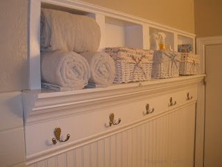 DIY Instructions for creating beautiful storage space within bathroom walls - make wooden frames to fit in slightly recessed cuts between the studs, a short-depth shelf, and trim with crown molding on top and bottom - great storage without taking up a lot of room. Love the idea, particularly for a small bathroom.