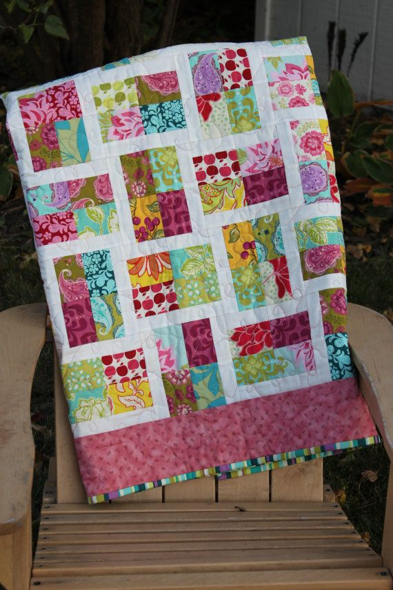 Great quilt for a jelly roll! Quilt measures: 50 inches by 62 inches. Will fit most toddler beds.