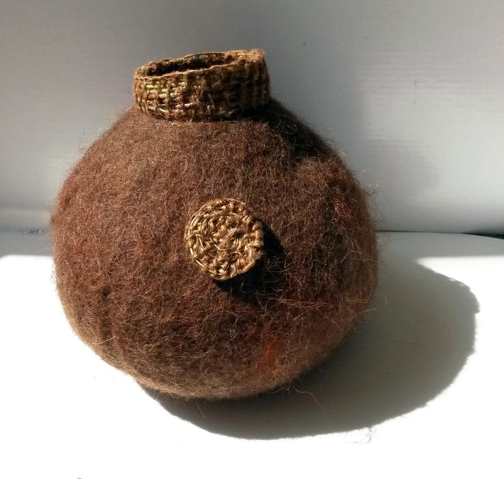Wet felted vessel made from natural brown wool and woven weeds. Summer 2015