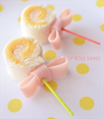 Lollipop sandwich. Site in Chinese, but picture gives a good idea.  I think it is a cheese sandwich roll with a ham bow held by toothpick.  Cute for a baby shower.