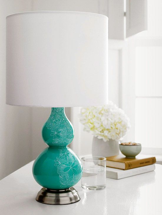 """Lighter than Lace-- """"Brighten a basic solid-color lamp base with delicate motifs. A white oil-pant marker is the perfect tool to put your sketches in the spotlight. Draw simple spirals and interlocking paisley or flower patterns for an intricate look. Start at the top and work your way down for the best results.""""  --BHG"""
