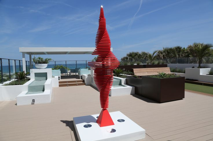 Florida oceanfront terrace with eight-foot-tall kinetic RALFONSO Flamenco sculpture.