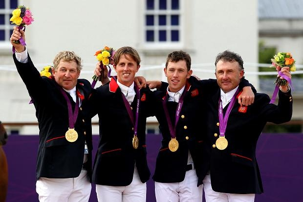 Aug 6 The Team GB equestrian gold medallists celebrate on the podium
