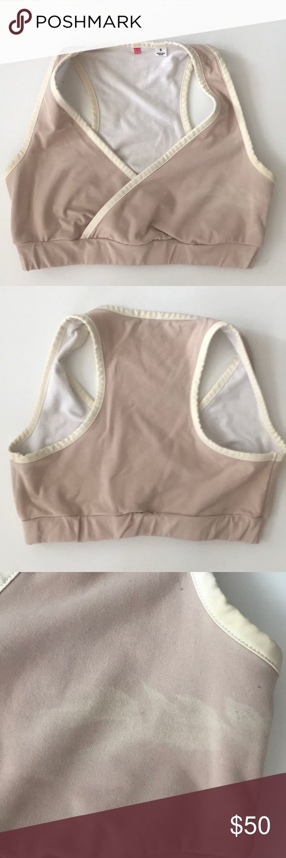 beautiful pale pink bra top- uniqlo Gorgeous pale pink nude neutral beige bra top by japanese favorite - uniqlo. size Small basics. perfect for layering daily or as a low impact sports bra for yoga. only worn once. in great condition save a light white marking on one side ( see second photo) that looks like a feather design. such a beautiful piece racerback. cross front  ( similar to alo, onzie, teeki, varley, vimmia, gymshark, lna, zara, Uniqlo Intimates & Sleepwear Bras