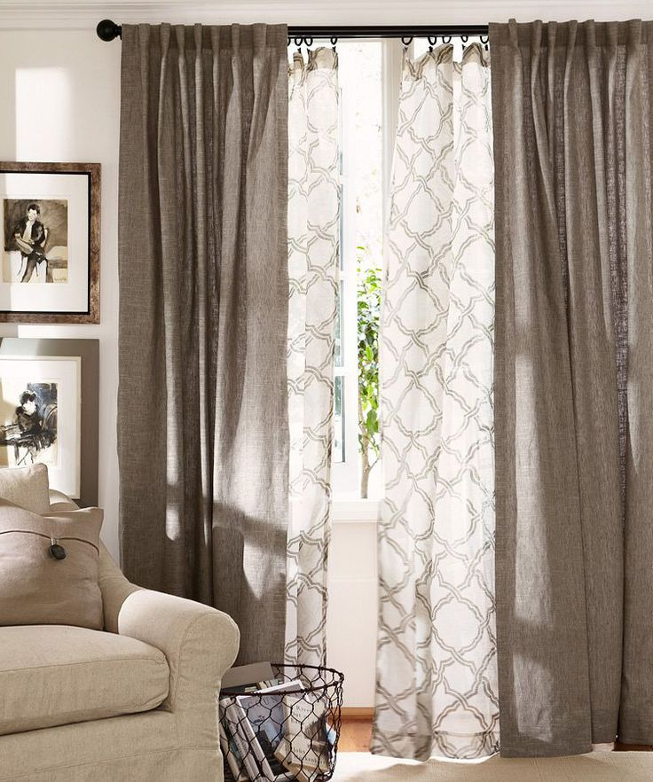 Layer curtains in the living room. Love this pattern and